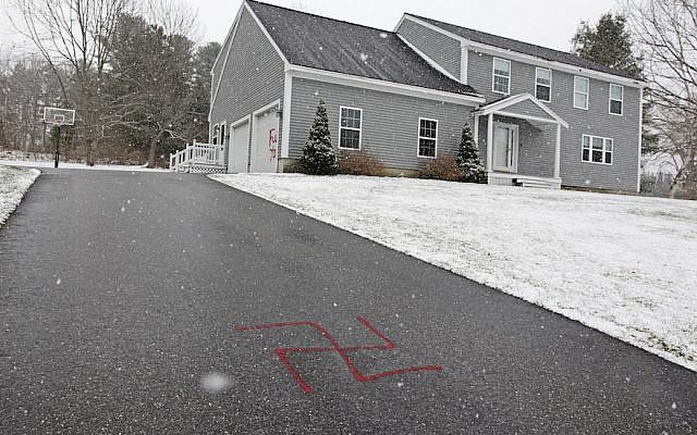 An illustrative photo of a driveway vandalized with a swastika. (Jill Brady/Portland Press Herald via Getty Images/via JTA)