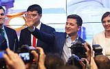 Volodymyr Zelensky, second from right, waves to supporters at his campaign headquarters in Kiev, Ukraine, April 21, 2019. He won the country's presidential election with over 70 percent of the vote. (Xinhua/Sergey/Getty Images/via JTA)