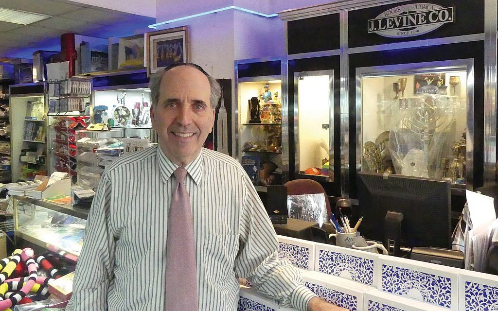 """""""I've had a good life here,"""" Daniel Levine said of his 33 years at Midtown Jewish bookstore. NORA WESSON"""