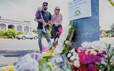 A makeshift memorial for the victims of the Chabad of Poway. A gunman inspired by white nationalists opened fire during Passover prayers, killing one and injuring three. Getty Images