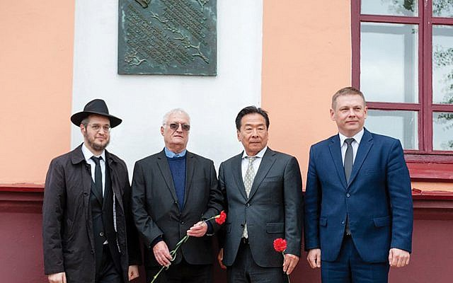 Nobuki Sugihara, second from right, with Chaim Chesler, in blue shirt, and guests of Limmud FSU Minsk at the village of Mir, Belarus, during an unveiling this month of a plaque for Chiune Sugihara.Boris Brumin