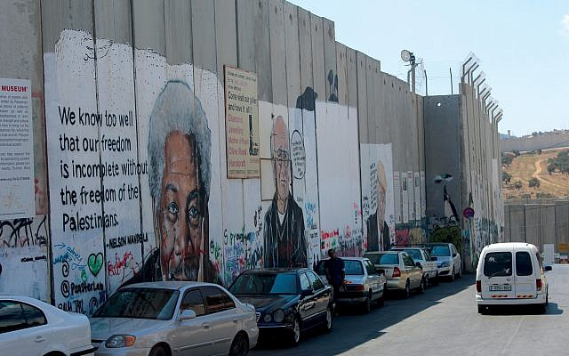 The art of resistance: Images of Nelson Mandela, Larry David and President Trump on Israel's security fence. Eli Reiter/JW