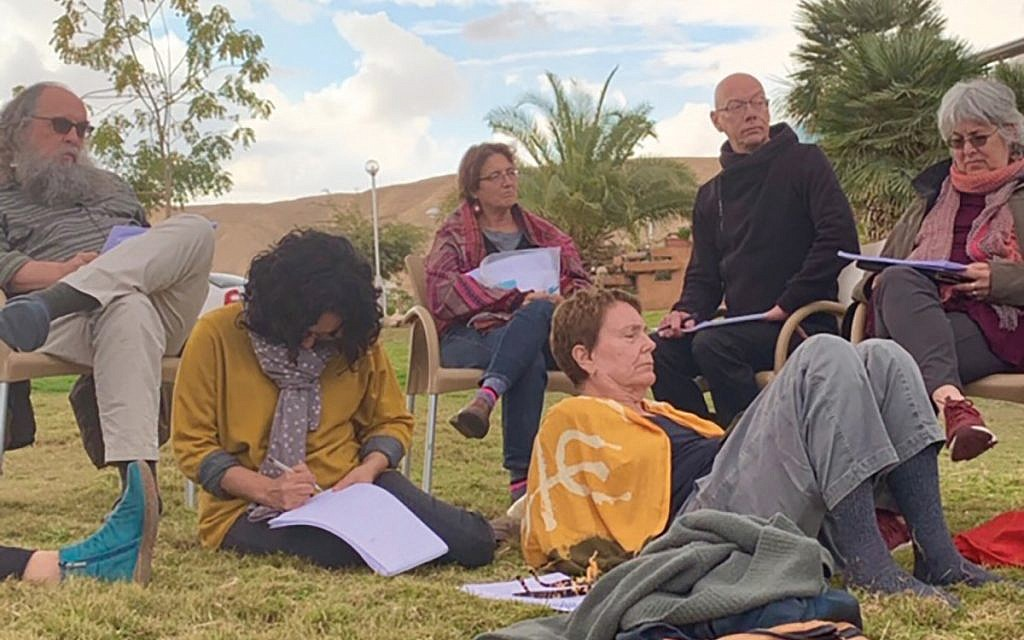 New Yorkers and Israelis, part of the Bavli Yerushalmi study group, pore over texts at Kibbutz Yahel in the Negev. Courtesy of Bavli Yerushalmi
