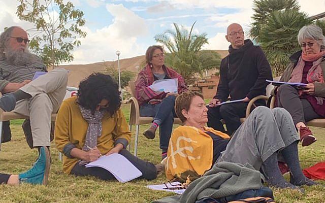 New Yorkers and Israelis, part of the Bavli Yerushalmi study group, pore over texts at Kibbutz Yahel in the Negev. Courtesy of Bavli Yerushalmi