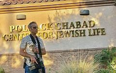 "Sign of the times: A congregant outside of the Chabad of the East Valley in Chandler, Ariz. The shul's rabbi says the man owns an Israeli-made automatic weapon that he ""keeps in his car"" during services. Courtesy of Chabad of the East Valley"