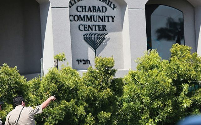 Police patrol in front of the Chabad of Poway near San Diego, site of the shooting rampage last week that left a congregant dead and three injured. Getty Images
