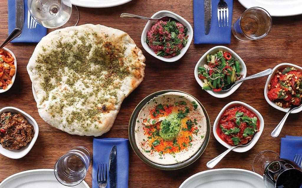 A spread at Zahav, Michael Solomonov's James Beard award-winning restaurant in Philadelphia which boasts many foods from the chef's Israeli heritage. Courtesy of Zahav/Alexandra Hawkins