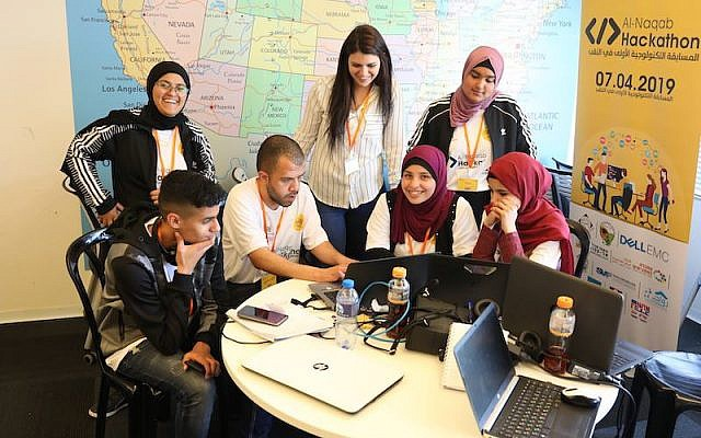 Bedouin high schoolers at a recent Hackathon, the first of its kind, in Beersheva. The event is part of a growing move to bring the traditionally minded Bedouins into Israel economic mainstream. Courtesy of Siraj