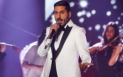 """Israeli singer Kobi Marimi performs during the reality TV show """"The Next Star for Eurovision."""" Marimi was announced as the country's representative to the Eurovision Song Contest after winning in the TV show.  MENAHEM KAHANA/AFP/Getty Images"""