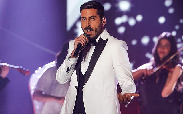 "Israeli singer Kobi Marimi performs during the reality TV show ""The Next Star for Eurovision."" Marimi was announced as the country's representative to the Eurovision Song Contest after winning in the TV show.  MENAHEM KAHANA/AFP/Getty Images"