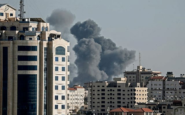 Smoke billows above buildings during an Israeli airstike on Gaza City on May 4, 2019. MAHMUD HAMS/AFP/Getty Images