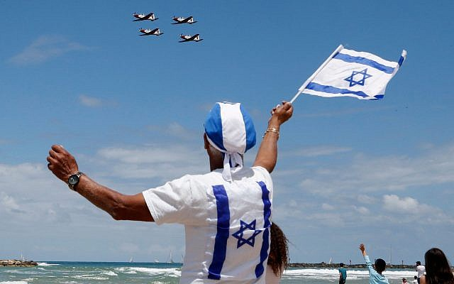 Photo for illustrative purposes: Israelis watch while Efroni T-6 Texan II planes perform during an air show, over the beach in the Mediterranean coastal city of Tel Aviv, on May 9, 2019 as Israel marks Independence Day, 71 years after the modern Jewish state was established. Getty Images