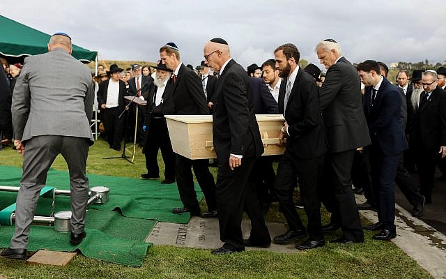 Pallbearers carry the casket of shooting victim Lori Gilbert Kaye during a graveside service on April 29, 2019 in San Diego, California. Lori Gilbert Kaye was killed inside the Chabad of Poway synagogue on April 27 by a gunman who opened fire as worshippers attended services. Getty Images