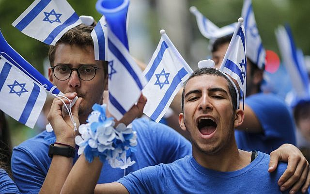 People participate in the annual Celebrate Israel Parade on June 3, 2018 in New York City. Security will be tight for the parade which marks the 70th anniversary of the founding of Israel. Getty Images