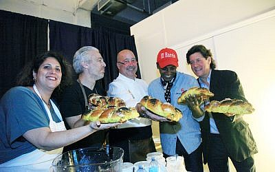 Chef's and organizers of the Harlem EatUp! shabbat dinner break bread together. Courtesy of Roy Anthony Morrison/Suite24k