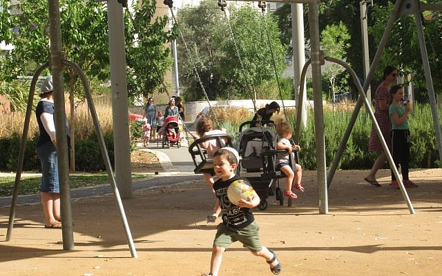 Due to the measles outbreak in Israel, outdoor playgrounds are one of the few places Israeli parents feel safe bringing their young children. Michele Chabin/JW