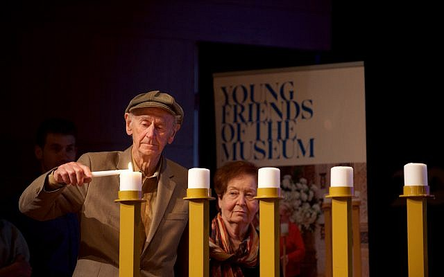Holocaust survivor Manny Lindenbaum lights a candle at The Museum of Jewish Heritage on Thursday evening. Courtesy of Perry Bindelglass