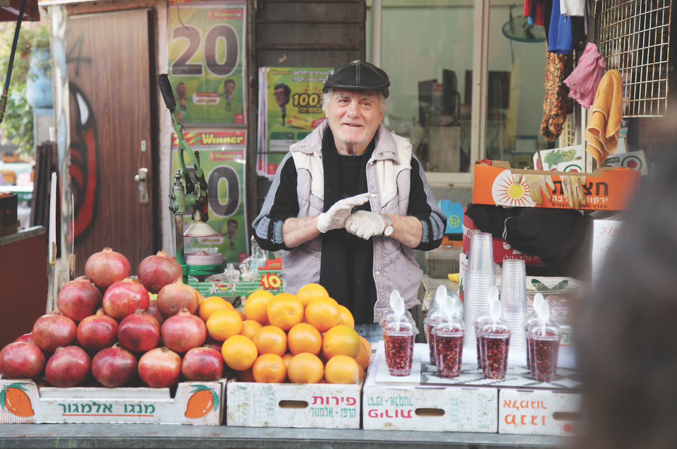 A vendor at Shuk Hacarmel in Tel Aviv smiles for the camera of one of the participants on the celebrity chef trip to Israel. Courtesy of Herb Karlitz