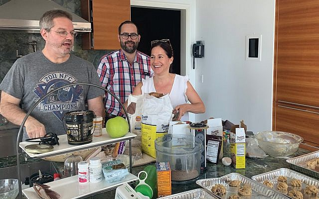 Chipping away: Co-author Moshe Horn, mashgiach Rabbi Yossi Teichman and Dava Schaub, chief program officer at the Marlene Meyerson JCC Manhattan, preparing chocolate chip cooks for all-night Shavuot event.