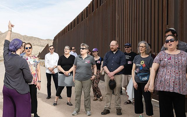 The author, with gray shirt and sunglasses, with rabbinic delegation at the U.S.-Mexico border. The group conducted a Mincha service there. Photos courtesy of T'ruah