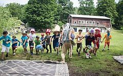 """Activities at Eden Village. """"More and more campers and staff were saying 'the gender binary is not working for me,"""" Eden Village director Yoni Stadlin says."""