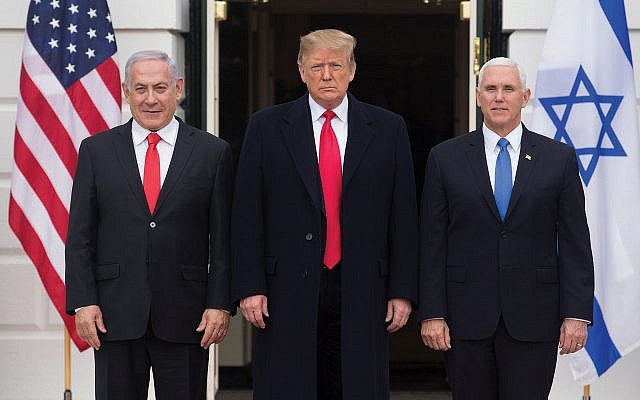 President Donald Trump is flanked by Israeli Prime Minister Benjamin Netanyahu, left, and Vice President Mike Pence in Washington in March. Michael Reynolds – Pool/Getty Images