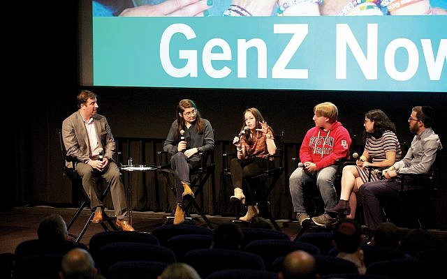Jewish Education Project's David Bryfman, left, with teens at event here discussing the findings of a major new study of Gen Z attitudes. Bindelglassphoto