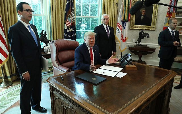Donald Trump sits in the Oval Office on June 24, 2019, after signing an executive order imposing new sanctions on Iran. Getty Images
