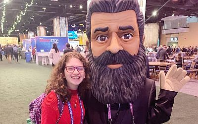 The author smiles for a photo with a Theodor Herzl character at the AIPAC Policy Conference in March.   Credit Liora Finkel