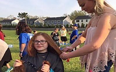 The author donating her hair last year. Courtesy of Rena Max
