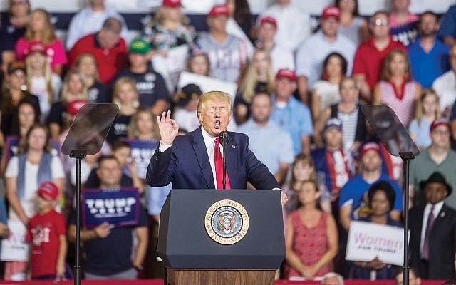 """President Trump at Greenville, N.C., rally where the crowd chanted """"Send her back,"""" a reference to Rep. Ilhan Omar. Getty Images"""