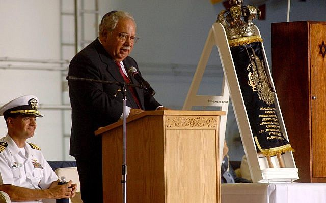 Mark Talisman speaks at a ceremony aboard the USS Harry S. Truman dedicating a Torah scroll, rescued from Lithuania, that was loaned with his help to the Navy vessel, June 24, 2007. (U.S. Navy/Wikimedia Commons/via JTA)