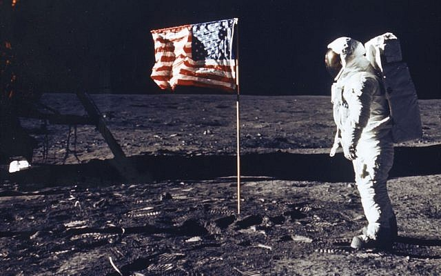 Astronaut Edwin E. Aldrin Jr. Poses For A Photograph Beside The Deployed Flag Of The United States. Getty Images