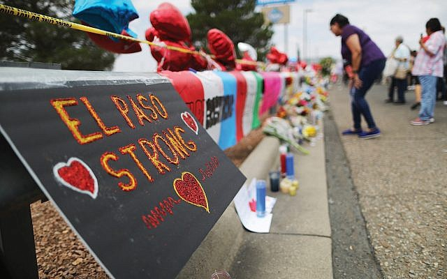 A makeshift memorial outside a Walmart in El Paso, near the site Saturday's mass shooting. Getty Images