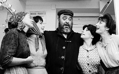 """Maria-Karnilova, left, Tanya Everett, Zero Mostel, Julia-Migenes and Joanna Merlin backstage at Sept. 22, 1964 opening of """"Fiddler on the Roof"""" at the Imperial Theater in Manhattan. AP/Courtesy of Roadside Attractions and Samuel Goldwyn Films via JTA"""