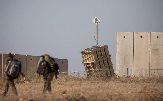 Israeli soldiers walk near an Iron Dome anti-missile battery in the southern Israeli city of Sderot, Aug. 9, 2018. (Yonatan Sindel/Flash90/via JTA)