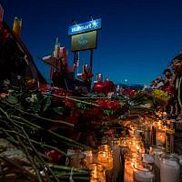 People pay their respects at the makeshift memorial for victims of the shooting that left a total of 22 people dead at the Cielo Vista Mall WalMart in El Paso, Texas, on August 6, 2019. Getty Images