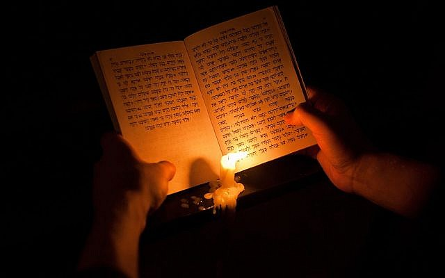 Reading from Megillat Eicha (Book of Lamentations) during Tisha B'Av in Jerusalem. Getty Images