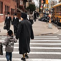 Pedestrians walk past a yeshiva in South Williamsburg, Brooklyn, in April. Getty Images
