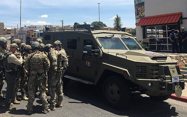 Armed police officers gather next to an FBI armored vehicle at the Cielo Vista Mall in El Paso, Texas, Aug. 3, 2019. The shooter who killed at least 22 people there is being investigated as a domestic terrorist. (Joel Angel Juarez/AFP/Getty Images/via JTA)