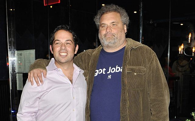 David Kimowitz, left, with comedian Artie Lange attend the grand opening of The Stand comedy club in New York City, Sept. 20, 2012. (Michael N. Todaro/Getty Images/via JTA)