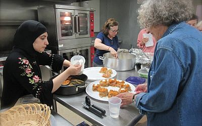 An Afghan refugee cooks her country's delicacies with members of Beth Am Shalom in White Plains. Bonnie Jill Emanuel