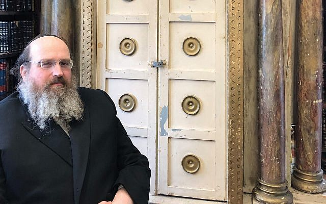 Rabbi Shaul Shimon Deutsch will part with post-Holocaust Torah ark to support his Jewish museum and food pantry. COURTESY OF GUERNSEY'S