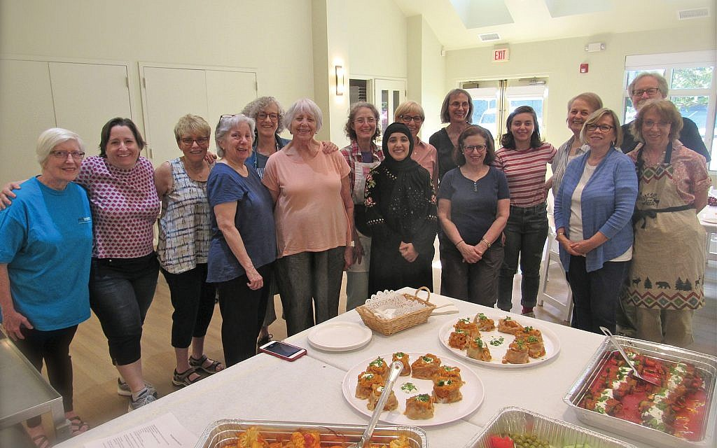 """An Afghan feast: For members of Beth Am Shalom, when it comes to helping refugees, """"It's easy to give money. Time is more difficult than money,"""" says Laura Solomon, the effort's point person. Courtesy of Bonnie Jill Emanuel"""