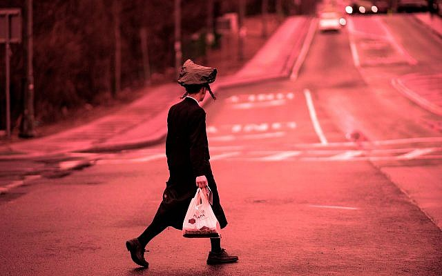 A Hasidic youth crossing a street in Monsey, Rockland County, New York. April 5, 2019. (Johannes Eisele/AFP/Getty Images/via JTA)