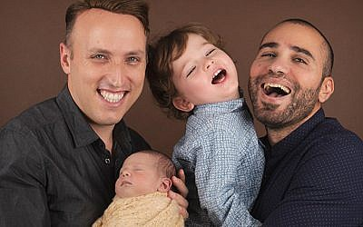 Roee and Adiel Kiviti, with their son and daughter Kessem. (Courtesy of Immigration Equality/via JTA)