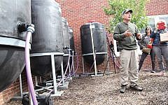 Amir Yechieli, an Israeli science teacher who designed the barrels, explains how they work at Hawthorne Elementary School in May 2017. ALEX FLAMHOLZ