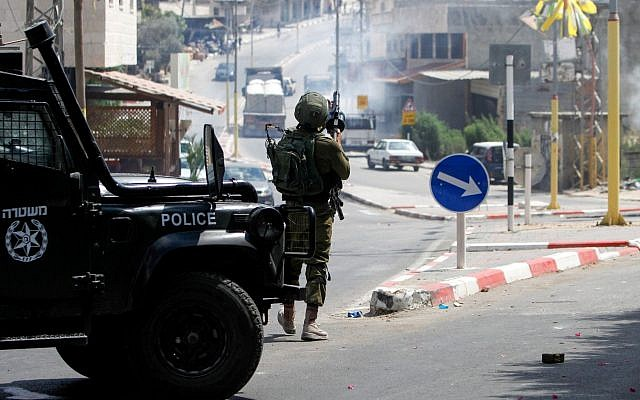 Israeli security forces clash with Palestinians during searches following a stabbing attack in the West Bank village of Azzun, on Sept. 7, 2019. (Nasser Ishtayeh/Flash90/via JTA)