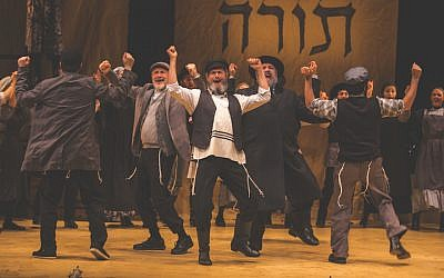 """Steven Skybell (Tevye), center, and ensemble in National Yiddish Theatre Folksbiene's Production of """"Fiddler on the Roof."""" (Victor Nechay/ProperPix)"""
