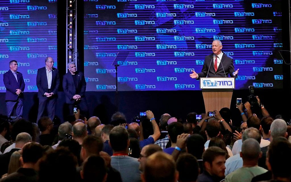 Benny Gantz (R), leader and candidate of the Israel Resilience party that is part of the Blue and White (Kahol Lavan) political alliance, addresses supporters at the alliance's campaign headquarters in the Israeli coastal city of Tel Aviv early on September 18, 2019, while flanked by other alliance leaders (L to R) independent Gabi Ashkenazi, Telem party's Moshe Yaalon, and Yesh Atid party's Yair Lapid.  Getty Images